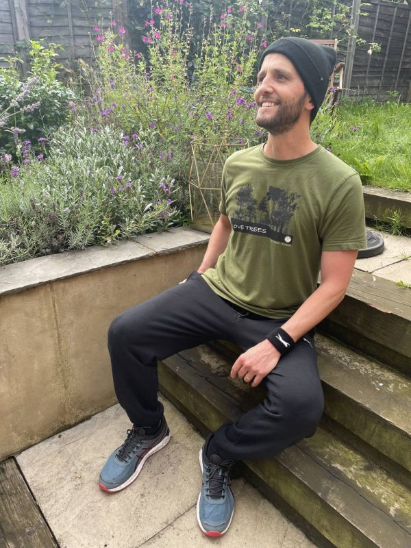 A male model wearing the Love Trees t-shirt